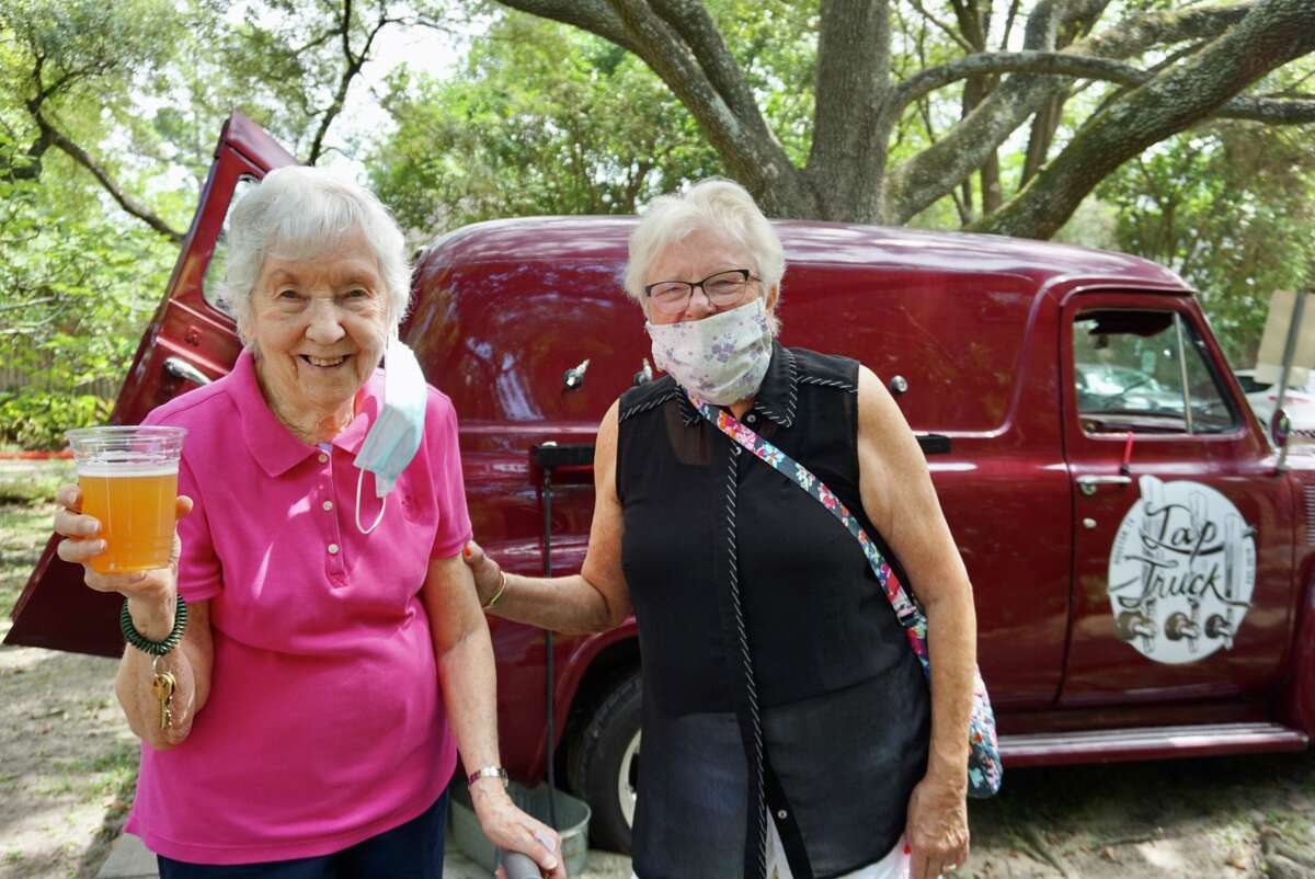 Treemont Resident Betty Stubbs (left) and cousin Charlene Phillips enjoy the Oktoberfest celebration, as the community re-opens to activities.