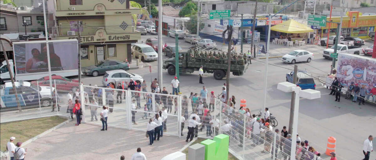 A Mexican military truck with soldiers patrol the baseball stadium in Nuevo Laredo, Mexico, during a 2019 home game of e Tecolotes de los Dos Laredo, a binational professional baseball team with home stadiums in Nuevo Laredo and Laredo, Texas.