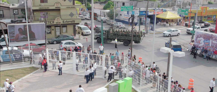 """A Mexican military truck with soldiers patrol the baseball stadium in Nuevo Laredo, Mexico, during a 2019 home game of e Tecolotes de los Dos Laredo, a binational professional baseball team with home stadiums in Nuevo Laredo and Laredo, Texas. """"Bad Hombres,"""" a new Showtime sports documentary, follows this AAA Mexican League baseball team that plays on both sides of the U.S.-Mexico border amid the tension around migration, divisive politics, and environmental concerns. Photo: Showtime, AP / Copyright 2020 The Associated Press. All rights reserved."""