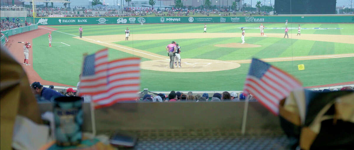 A 2019 game of Tecolotes de los Dos Laredo, a binational professional baseball team with home stadiums in Nuevo Laredo, Mexico, and Laredo, Texas, appears in a scene from