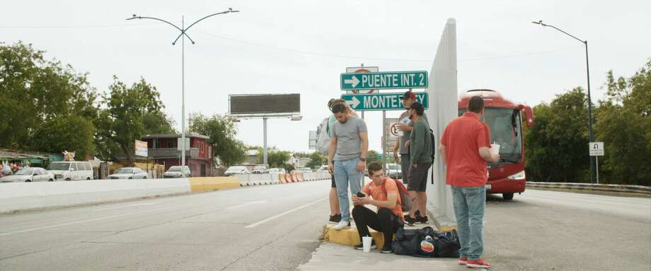 """Members of the Tecolotes de los dos Laredos wait for a bus at the border to take them to their baseball stadium. Showtime's documentary """"Bad Hombres"""" is centered on the Mexican League baseball team that plays half its home games in Laredo and the other half across the border in Nuevo Laredo. Photo: Showtime"""