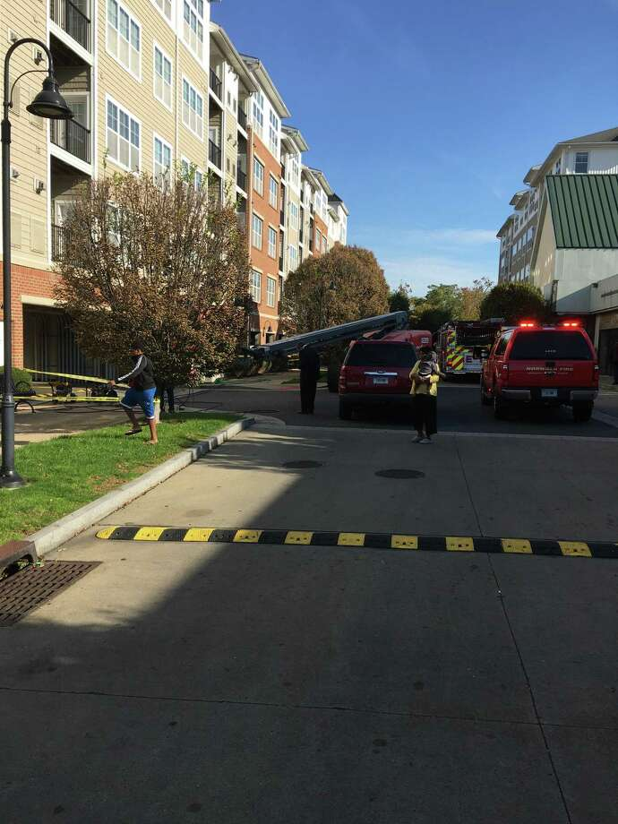 Firefighters respond to a fire at the Avalon Apartments at 26 Belden Ave. on Thursday, Oct. 15, 2020. Photo: Contributed Photo / Norwalk Fire Department