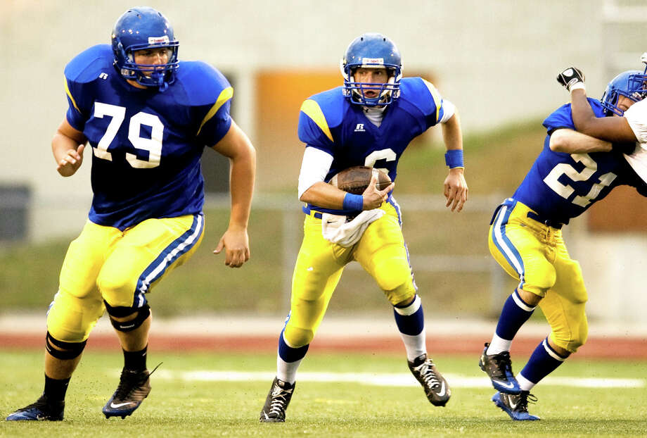 Midland High's Andrew Wylie (79) blocks for Alex Rapanos during a Sept. 24, 2010 game against Flint Southwestern. Photo: Daily News File Photo