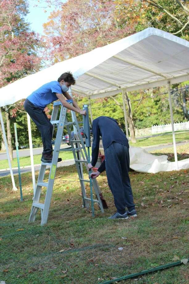 Jesse Lee Church volunteers help build the pumpkin patch. Photo: Jesse Lee Church
