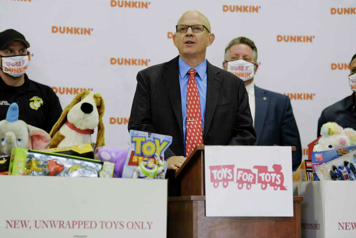Eric Stensland, field marketing manager for Dunkin' Brands, speaks at an event to launch the 2020 Toys for Tots toy drive on Thursday, Oct. 15, 2020, in Clifton Park, N.Y. Dunkin' Brands has donated $30,000 to the toy drive, and over the past 12 years Dunkin' has given $350,000 to the Toys for Tots campaign. (Paul Buckowski/Times Union)
