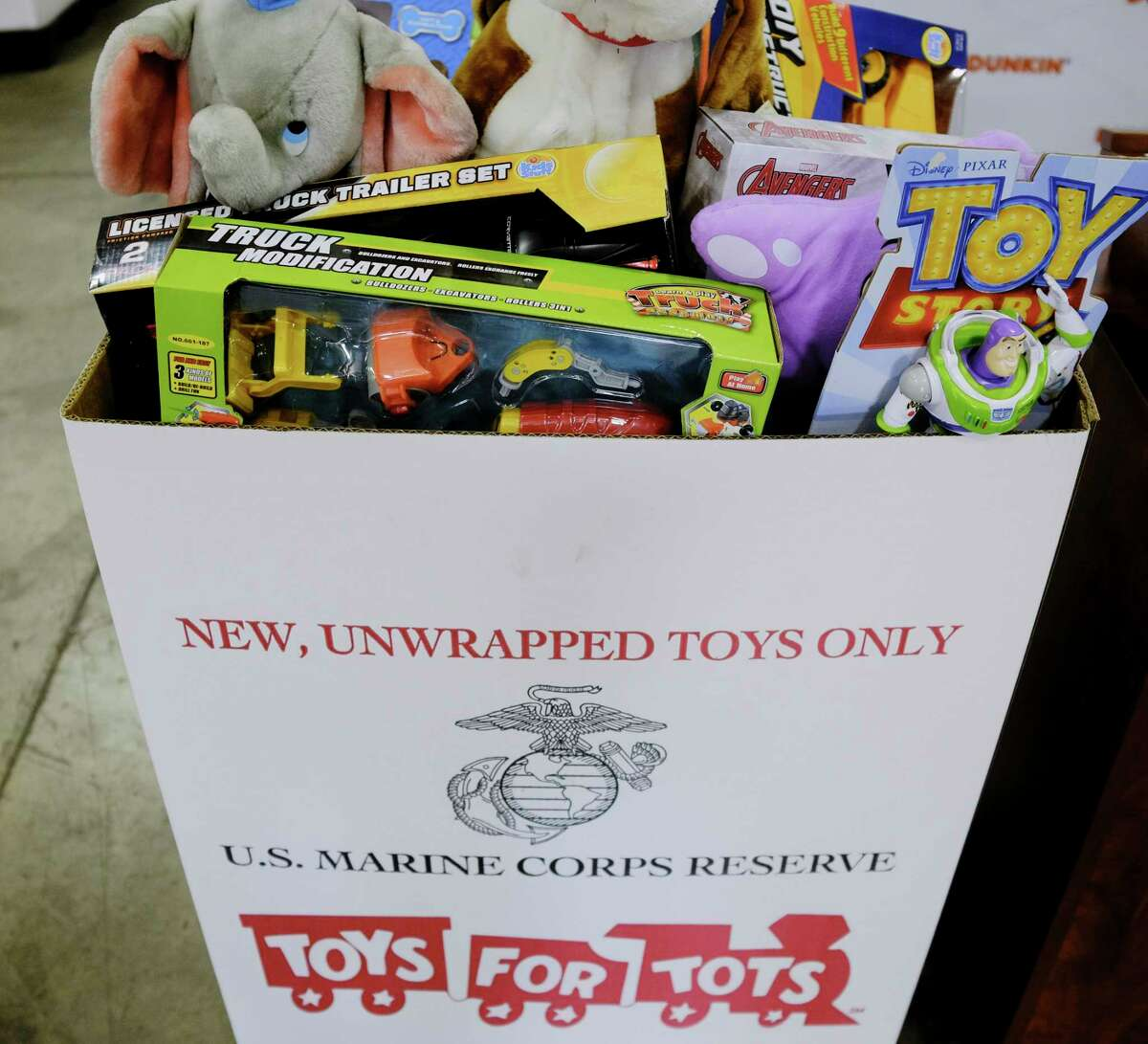 Veterans, members of the military, elected officials and representatives from various businesses gather to take part in a press event to launch the 2020 Toys for Tots toy drive on Thursday, Oct. 15, 2020, in Clifton Park, N.Y. (Paul Buckowski/Times Union)