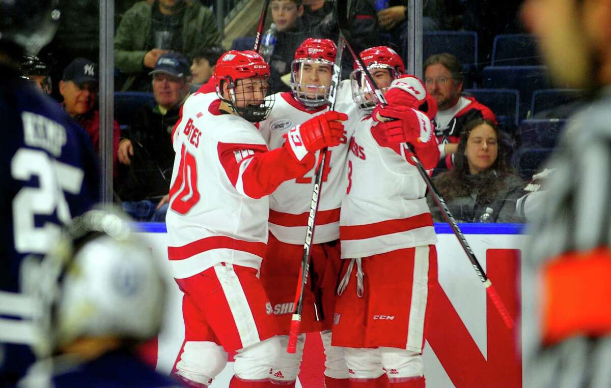 Sacred Heart University celebrates a goal by Austin Magera (24), in center, during Connecticut Ice Tournament action against Yale at the Webster Bank Arena in Bridgeport, Conn., on Saturday Jan. 25, 2020.