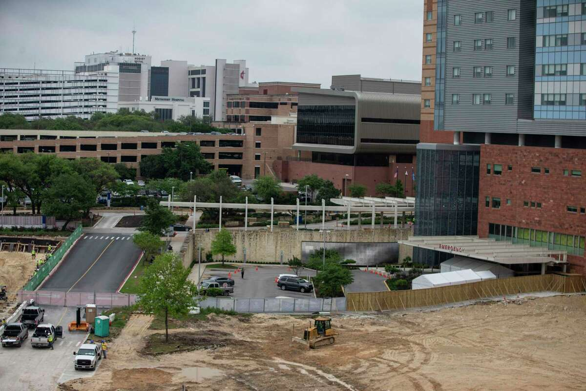 Parking lots at University Hospital were dug up to make way for the new women's and children's hospital as is seen in this April photo.
