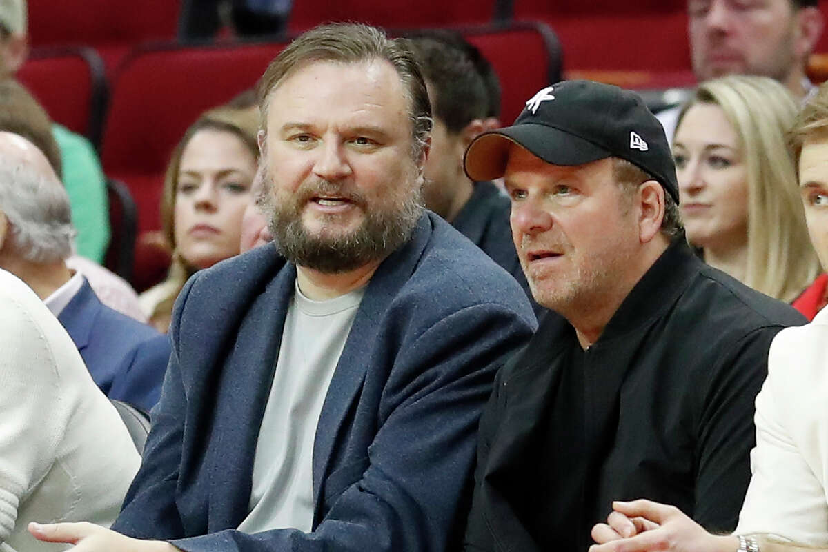 Ex-general manager Daryl Morey talks with owner Tilman Fertitta of the Houston Rockets during the game against the Orlando Magic at Toyota Center on March 8, 2020 in Houston, Texas.