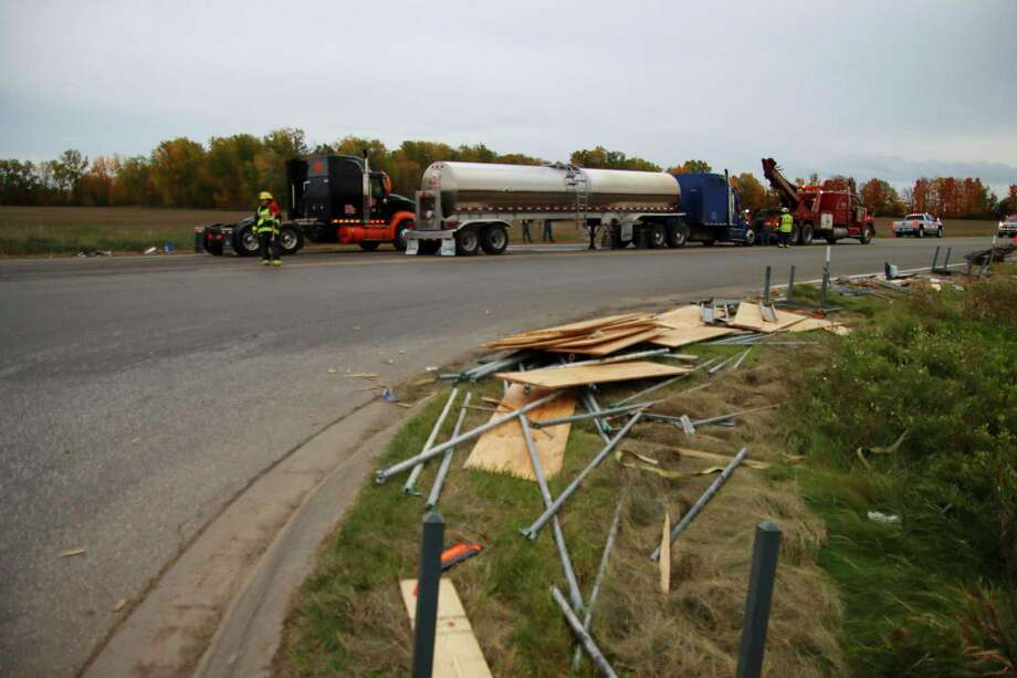 Sections of pipe and plywood are scattered on the southwest corner of Sebewaing Road after a collision between a semi truck and a trailer Oct. 15. (Scott Nunn/Huron Daily Tribune)