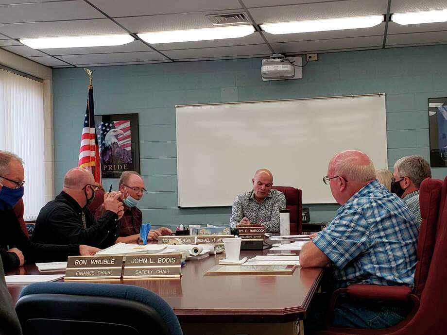 The county commissioners conduct their meeting earlier this week.(Robert Creenan/Huron Daily Tribune)