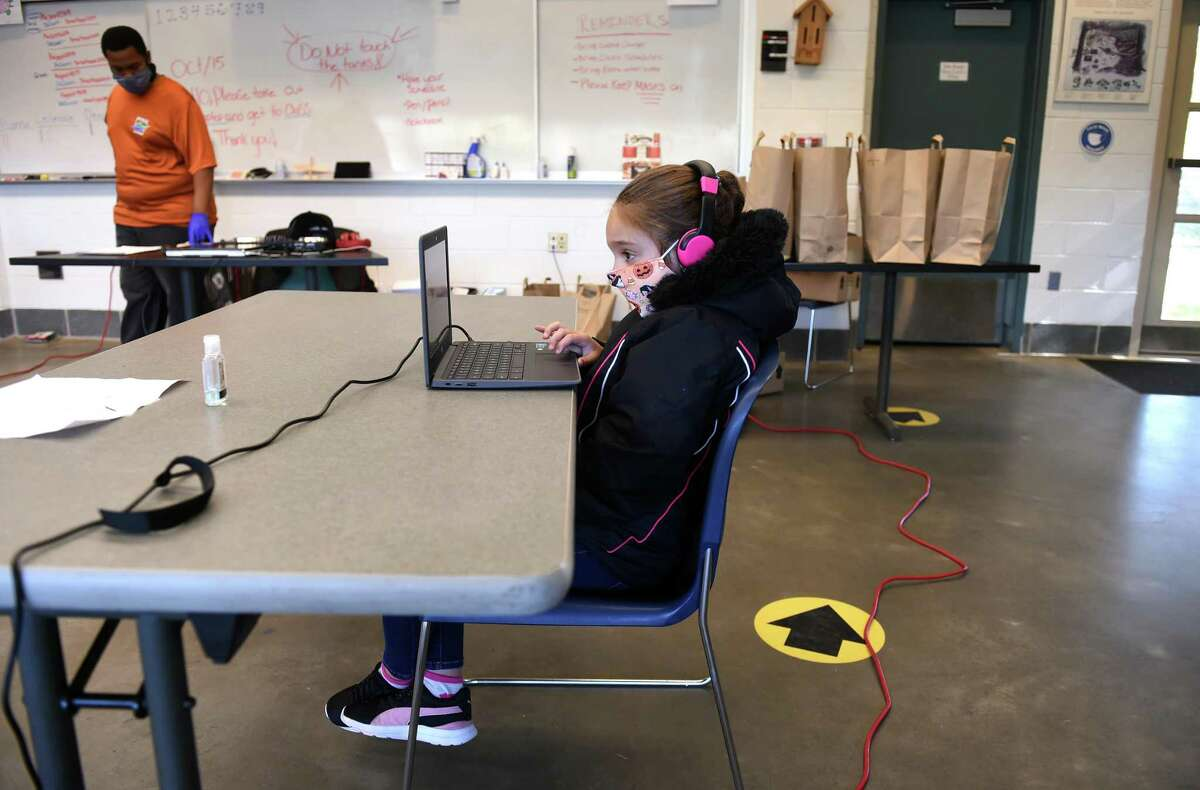 Fourth-grader Somaya Ortiz, 9, works on the computer at the New Haven Public School's learning hub on Ella Grasso Boulevard Blvd. in New Haven on Oct. 15, 2020.