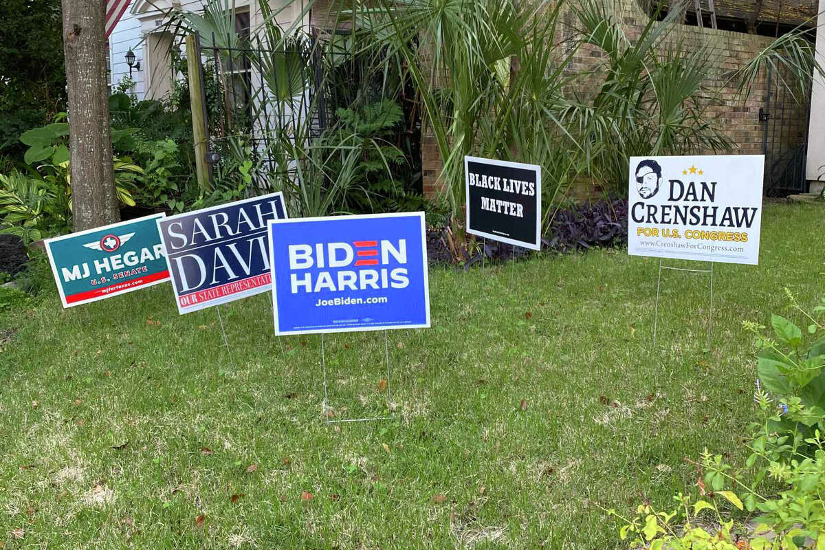 An array of signs for both Democratic and Republican candidates in front of this Montrose home, seen here on Oct. 14, 2020, has piqued interest on social media platforms such as Twitter.