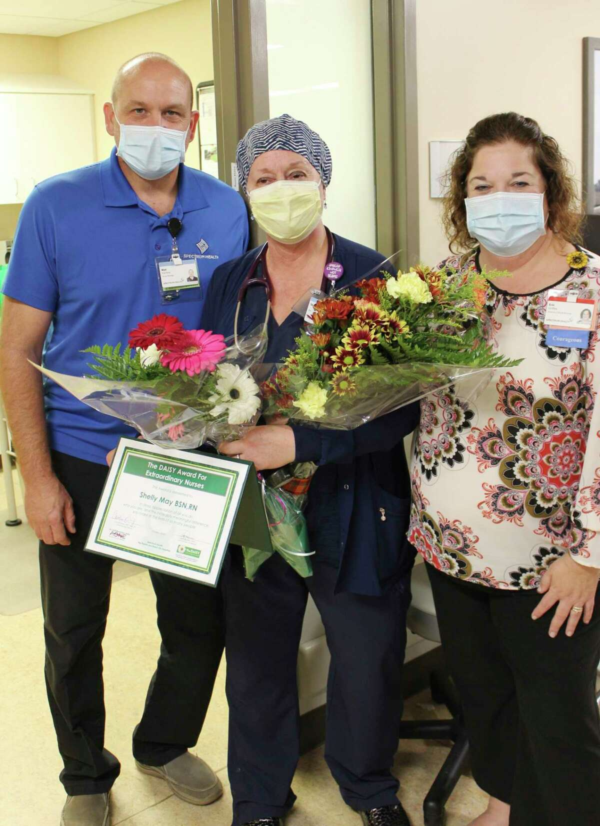 Shelly May, center, was recognized with a DAISY Award for her compassionate care shown to a recent patient needing emergency care. Shown with May are Walt Hartline, nurse manager of the Big Rapids Hospital emergency department and Erin Griffes, director of clinical nursing for Big Rapids and Reed City Hospitals. (Courtesy photo)
