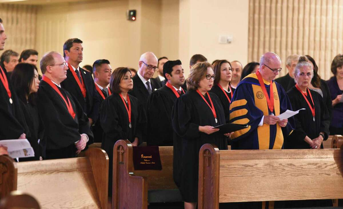 Community members working in the legal profession wear their robes and a medal during the 19th annual Red Mass event at St. Patricks Church on Oct. 1, 2019.