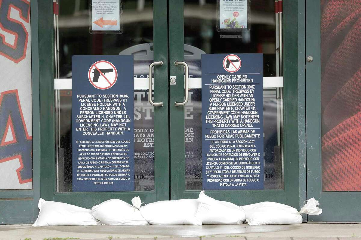 Sandbags line the doors to the Team Store at Minute Maid Park on Friday, Aug. 25, 2017, in Houston. ( Elizabeth Conley / Houston Chronicle )