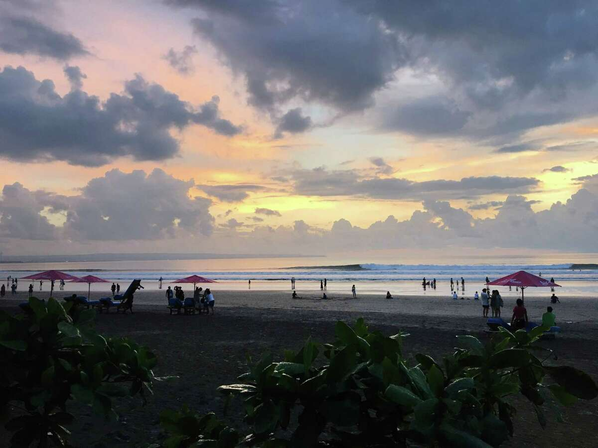 The sun sets over the beach in Seminyak, Bali. The author's long, multi-stop trip to Asia required significant advance planning.