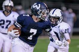 Wilton tight end Mike Coffey runs for extra yardage after making a catch in a game against Staples last year.