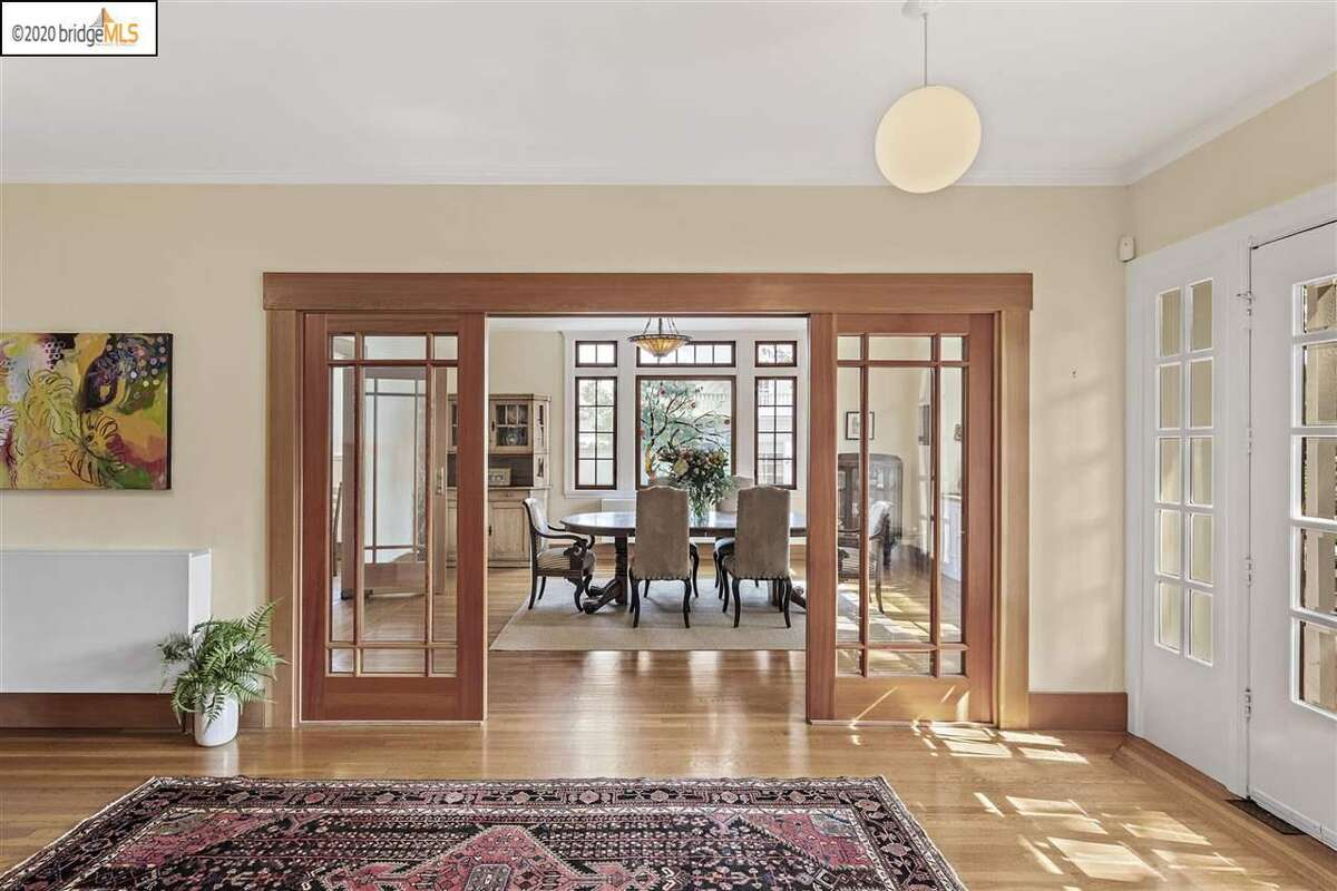 In the entry, sliding French doors were installed in the living and dining rooms to match the look and feel of the original wood windows in those rooms. The rooms can be totally enclosed, to allow for better heat retention, while still letting light into the spaces.