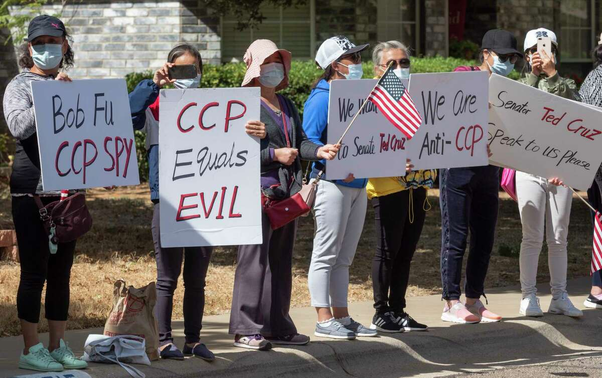 Chinese protestors continue 10/15/2020 to stand along Bishops Castle Drive, claiming Pastor Bob Fu is a communist spy. Tim Fischer/Reporter-Telegram