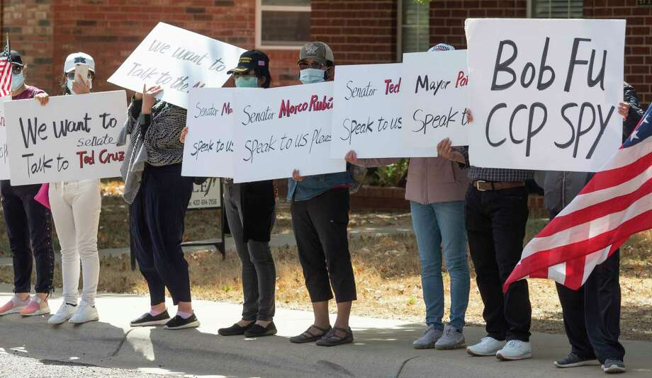 Chinese protestors continue 10/15/2020 to stand along Bishops Castle Drive, claiming Pastor Bob Fu is a communist spy. Tim Fischer/Reporter-Telegram Photo: Tim Fischer, Midland Reporter-Telegram