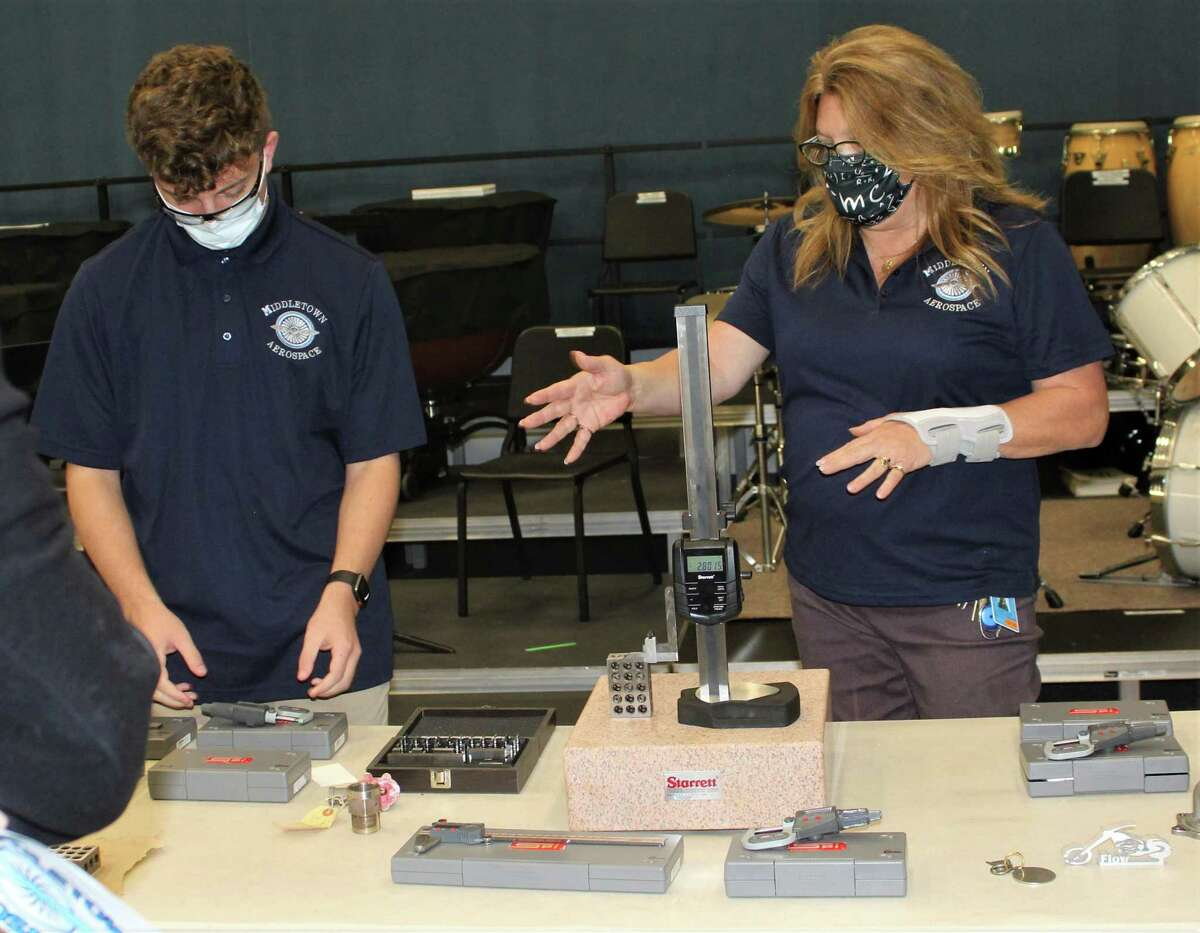 A Middletown High School Aerospace & Manufacturing Center student and teacher demonstrate various components involved in classes to the public.