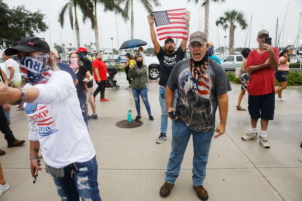 Supporters of President Donald Trump attend a counter-protest against a demonstration billed as a