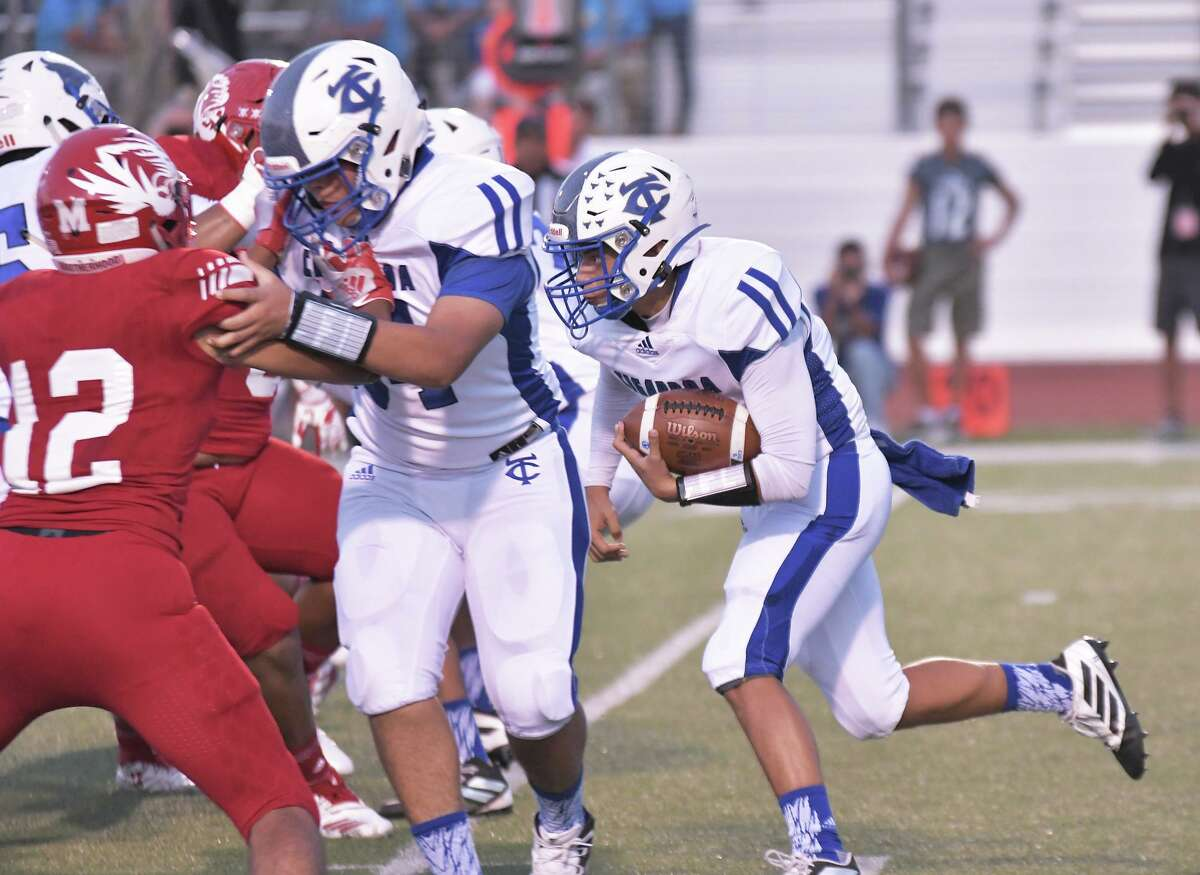 Quarterback Hector Solis gets a block from his teammate as he carries the ball for the Cigarroa Toros against the Martin Tigers Friday, September 13, 2019 at Shirley Field.