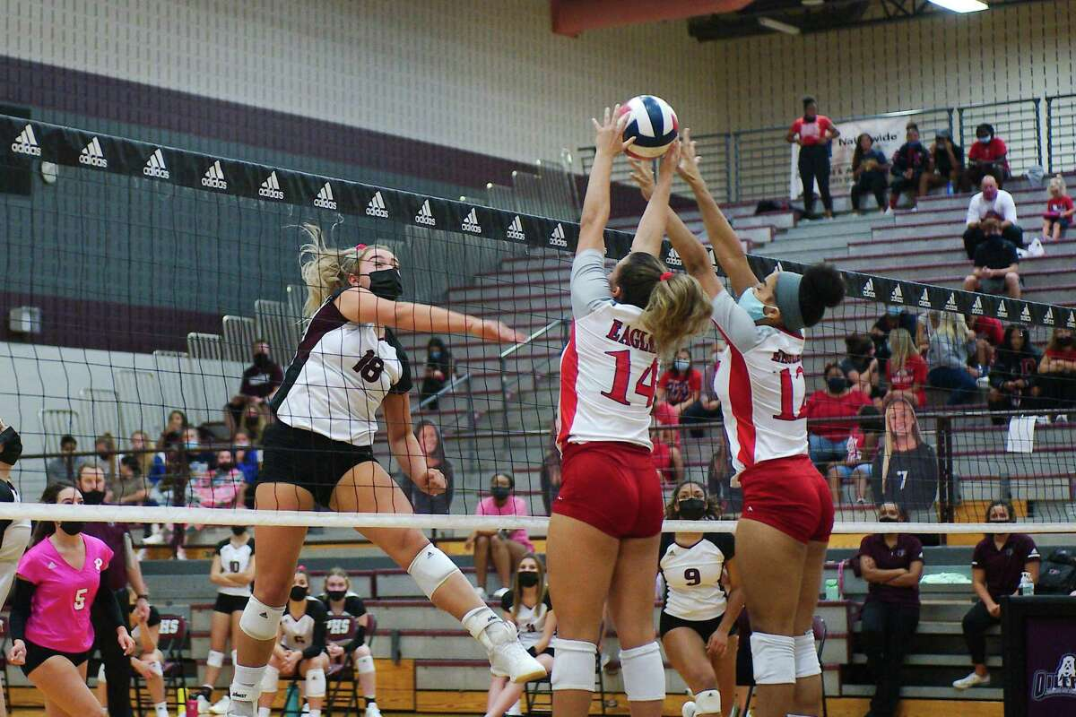 Pearland's Avery Schwartz (18) tries to hit a shot past Dawson's Kylie Nance (14) and Dawson Tuesday, Oct. 13 at Pearland High School.