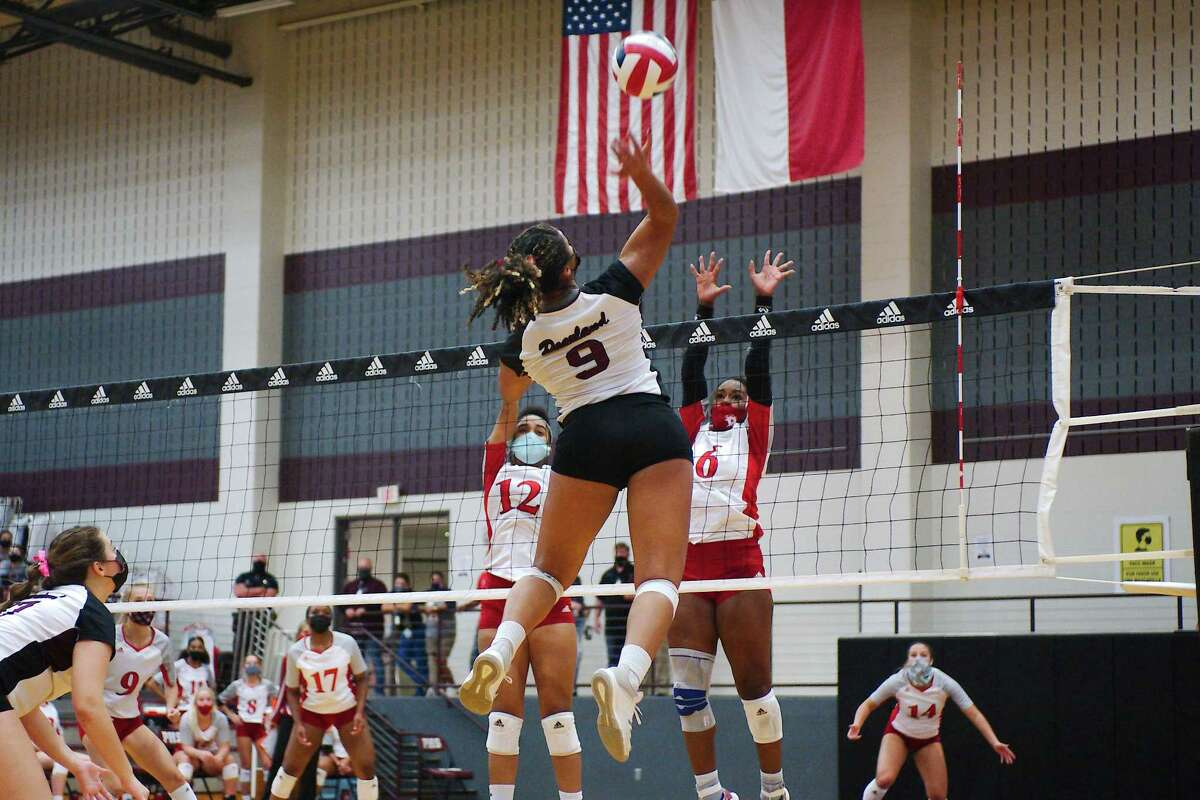 Pearland's Seleste Harris (9) elevates against Dawson's Ava Kennon (12) and Alexia Jones (6) Tuesday, Oct. 13 at Pearland High School.