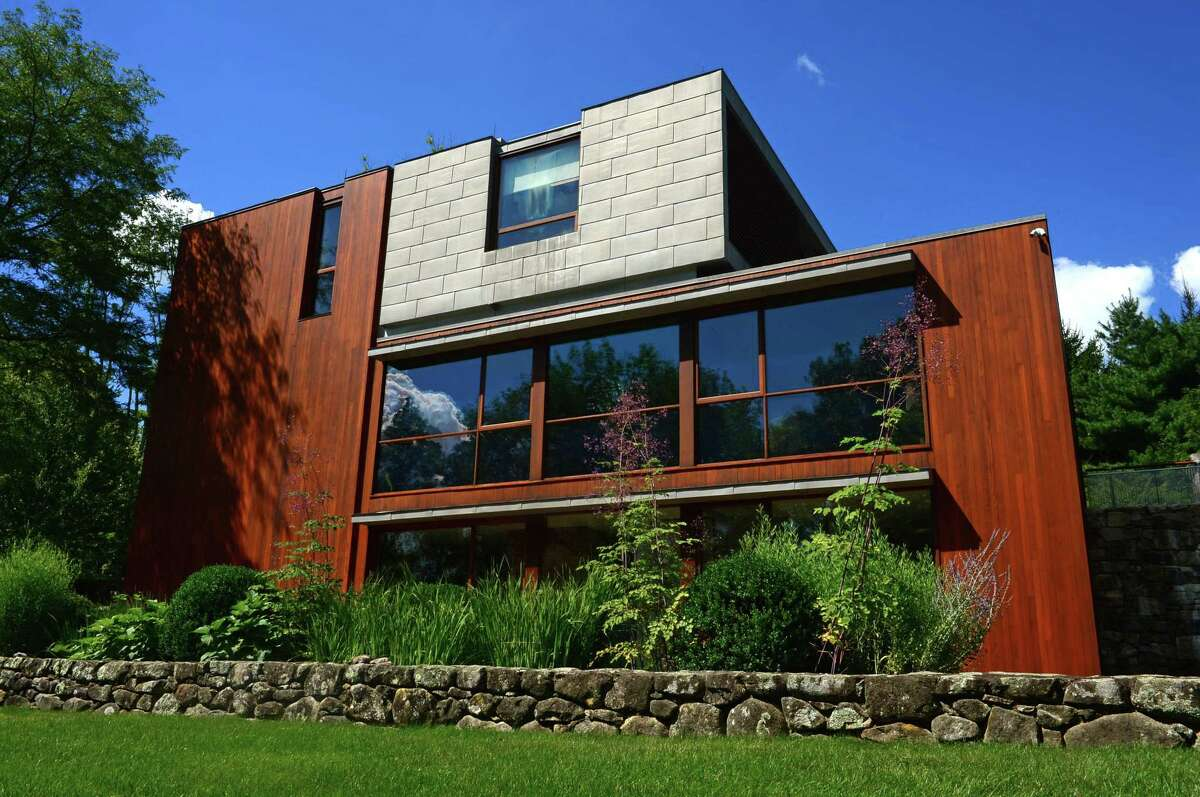 """The side exterior of the mid-century modern home designed by renown architect Eliot Noyes and referred to as """"The Brown House"""" at 81 Cross Ridge Road in New Canaan."""
