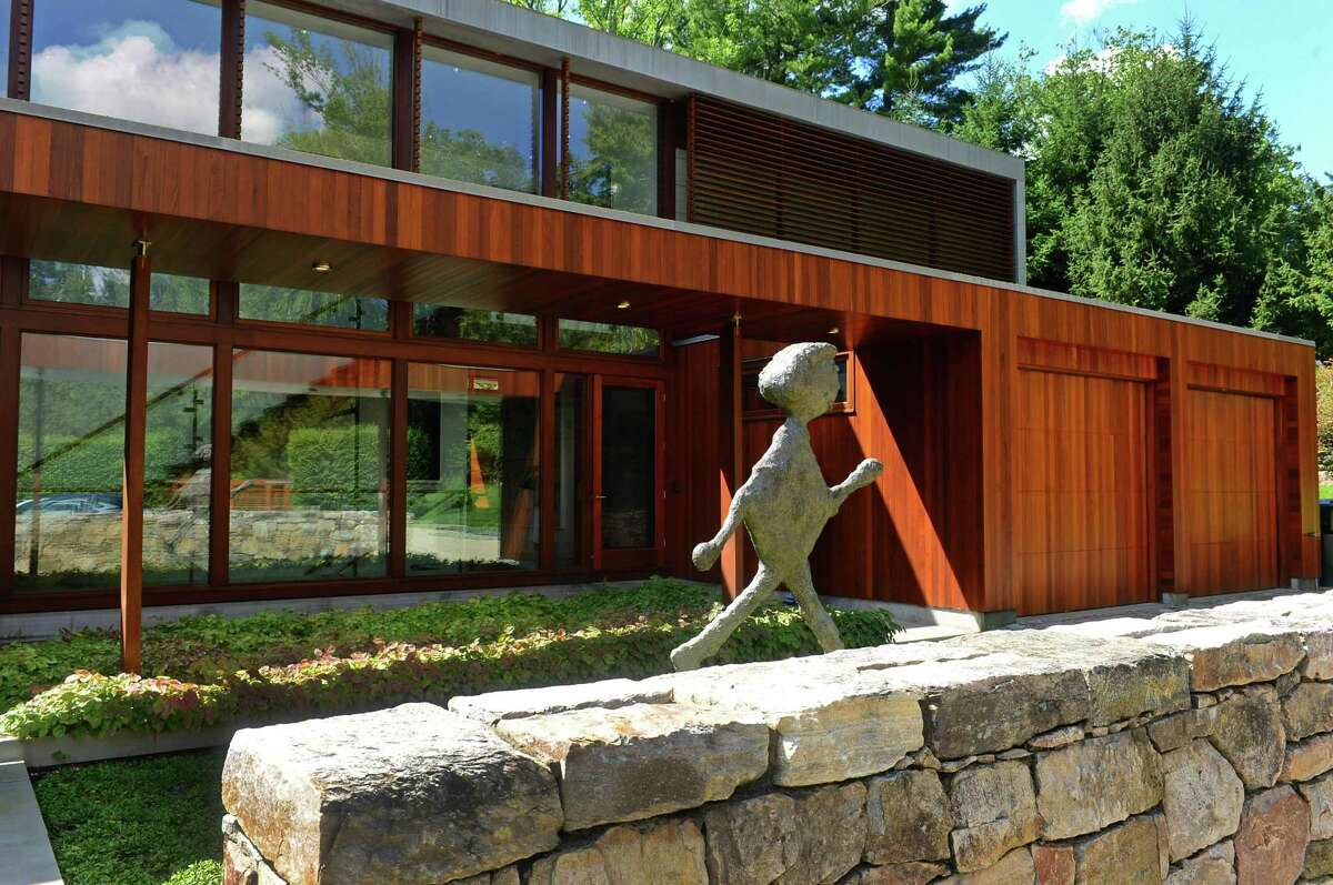"""The front exterior of the mid-century modern home designed by renown architect Eliot Noyes and referred to as """"The Brown House"""" at 81 Cross Ridge Road in New Canaan."""