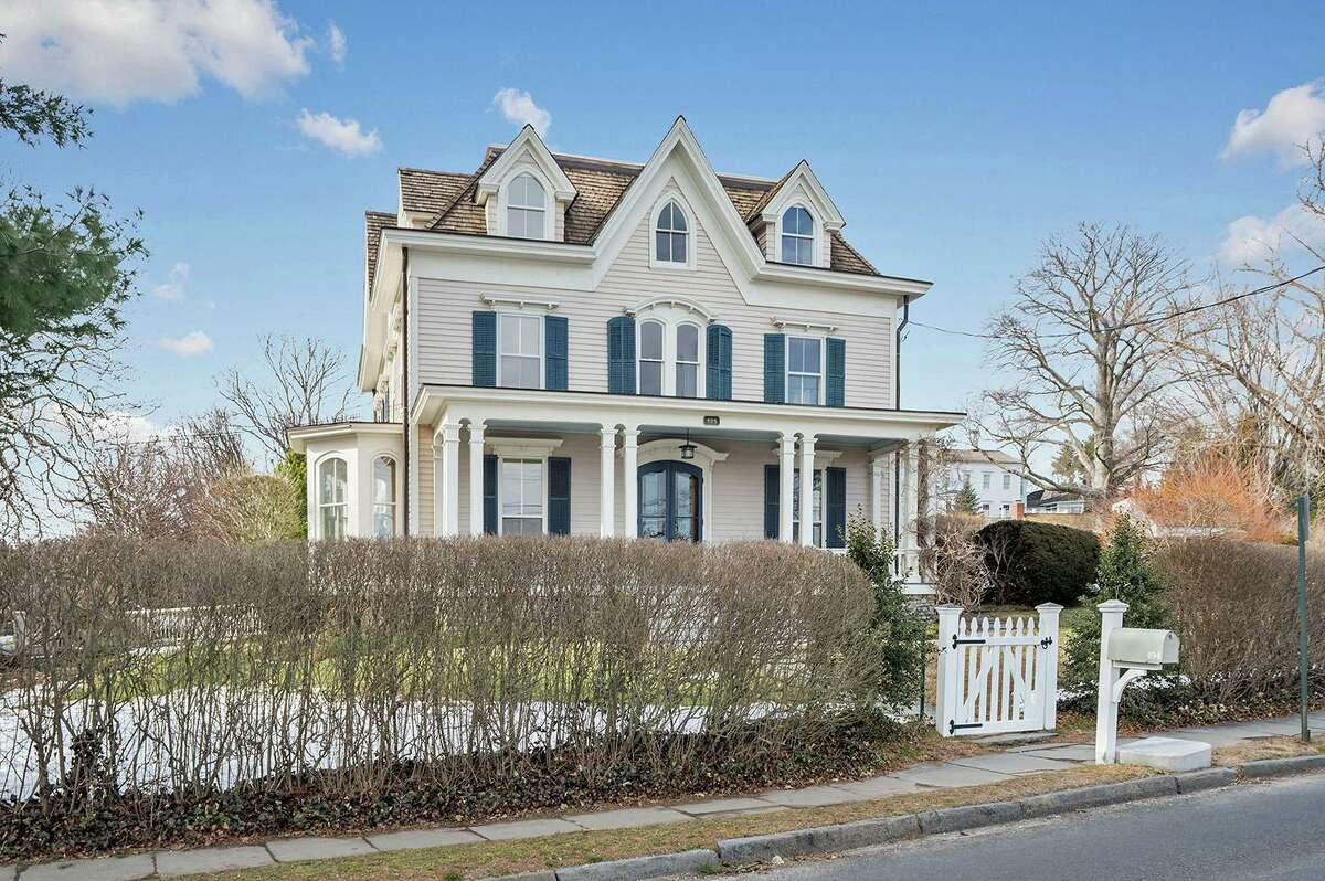The pale coral-colored antique colonial house sits on a third of an acre property in the Southport Village's historic district.