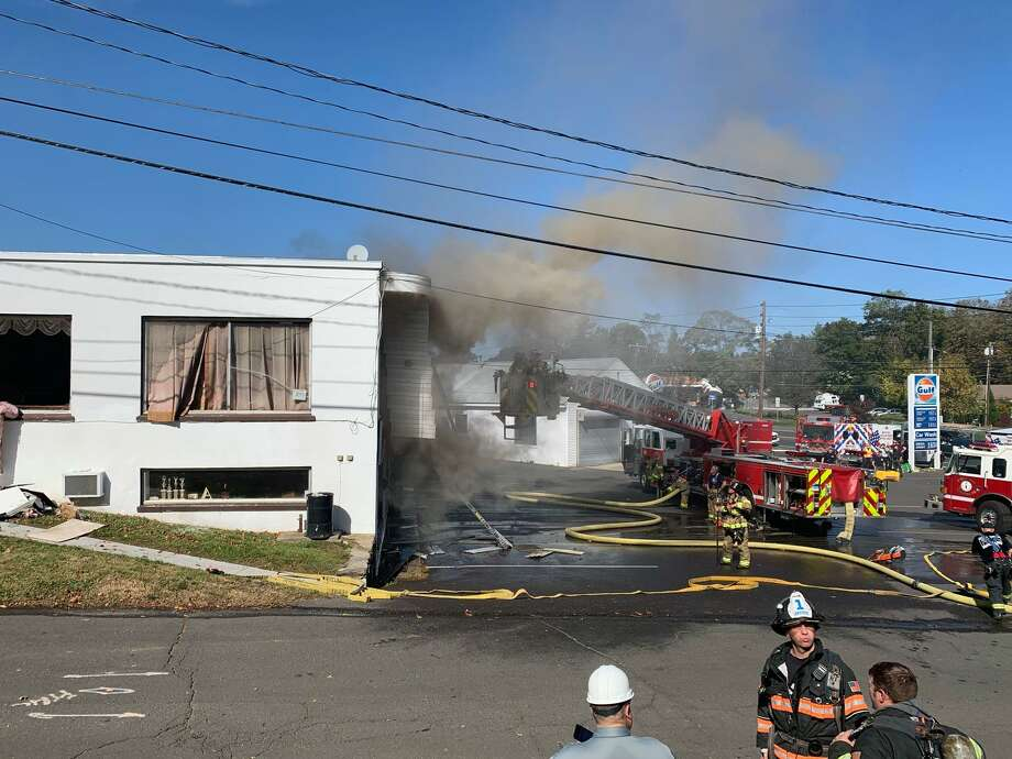 Firefighters work to put out a structure fire on Greenwood Avenue in Bethel, Conn., Oct. 15, 2020. Photo: Danbury Fire Department