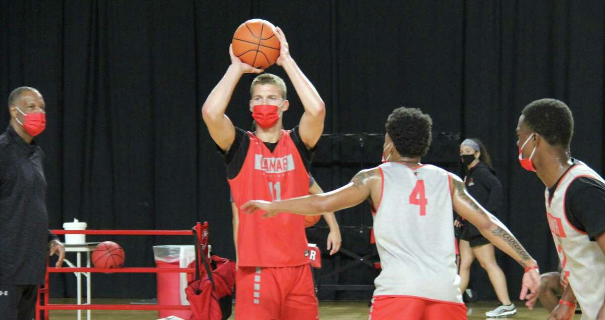 Lamar sophomore guard Anderson Kopp looks to pass the ball during a practice Wednesday at the Montagne Center.