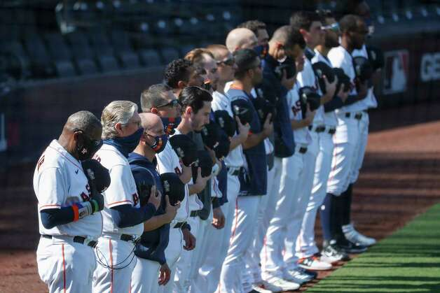 Houston Astros manager Dusty Baker, left, stands with his team during the national anthem before Game 5 of the American League Championship Series against the Tampa Bay Rays at Petco Park Thursday, Oct. 15, 2020, in San Diego. Photo: Karen Warren, Staff Photographer / © 2020 Houston Chronicle