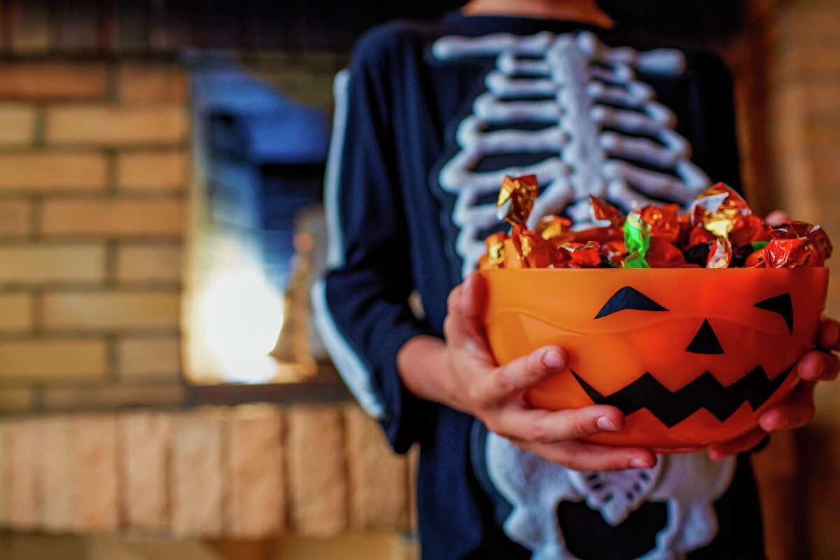 Get creative with at home trick-or-treating by pretending different doors in your home are houses to visit.