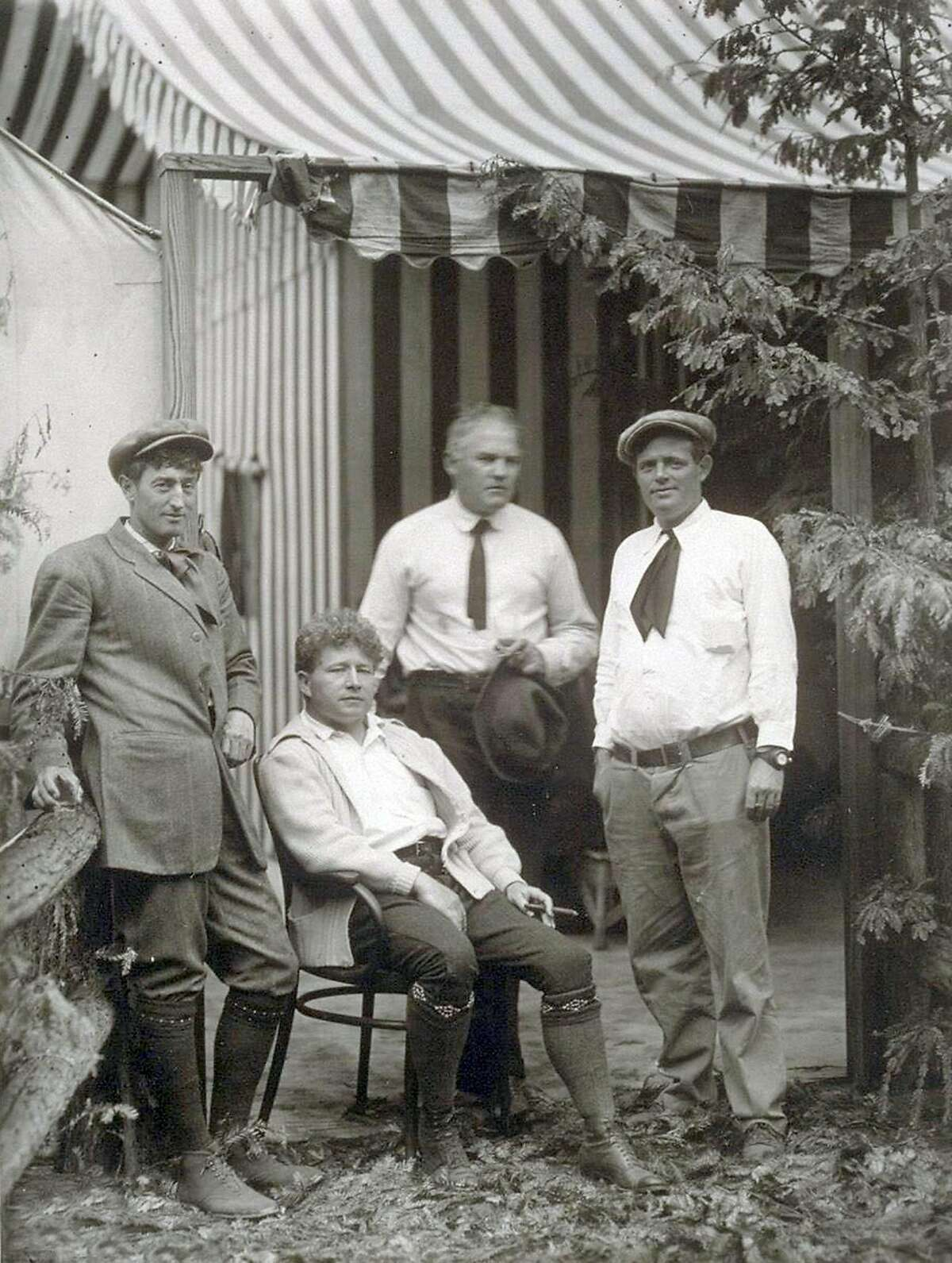 Poet George Sterling, a man of many contradictions (left), hangs out with journalist Jimmy Hopper and authors Harry Leon Wilson and Jack London at the Bohemian Grove in 1913.