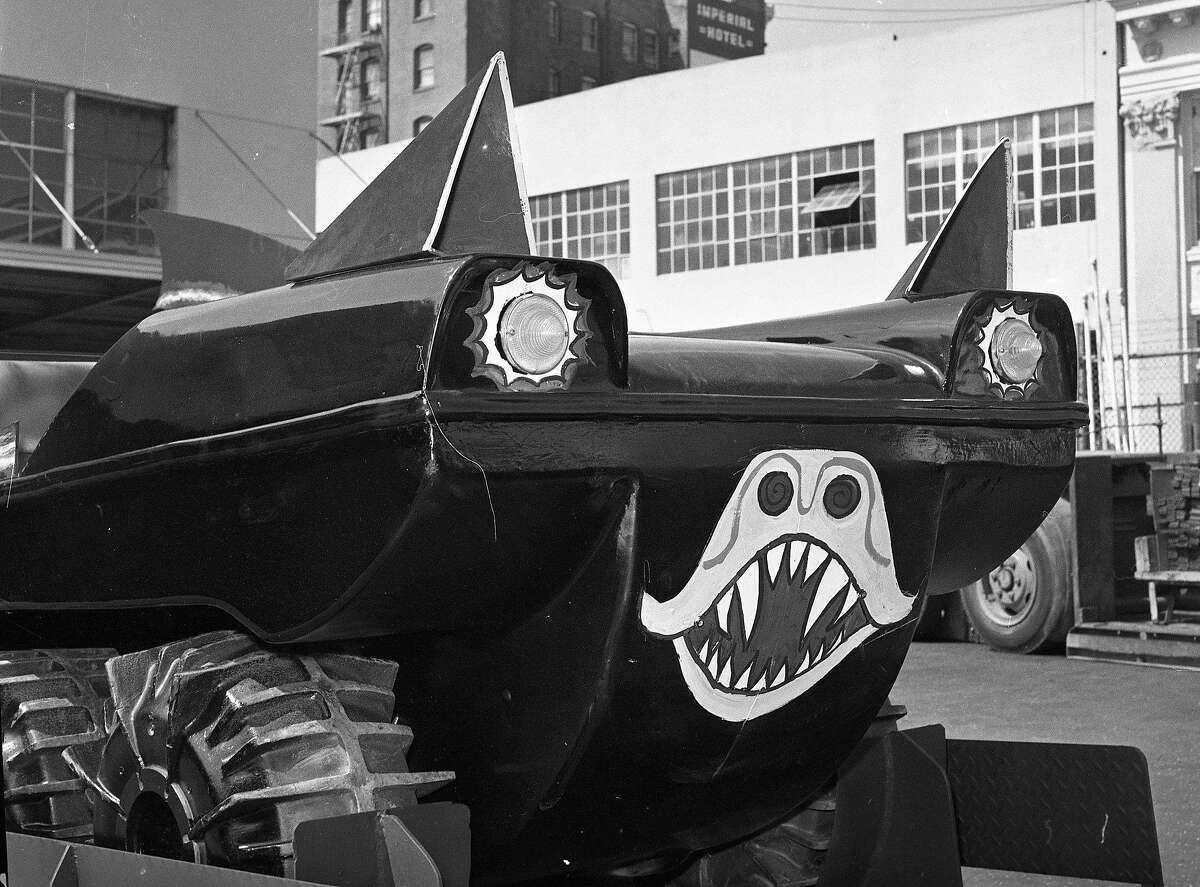 Batman was the hottest TV program in the summer of 1966, and The thought a good way to prompt the introduction of a nw Batman comic strip was to give away a replica Batmobile, seen here out side the paint garage of the old News-Call building, May 20, 1966