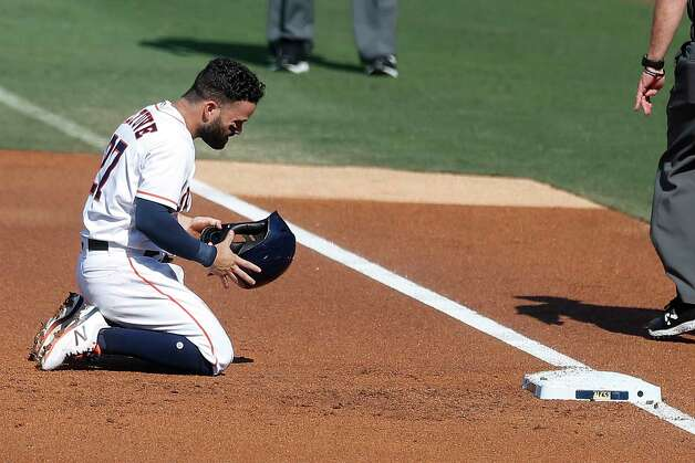 Houston Astros Jose Altuve kneels on the basepath after getting picked off first by Tampa Bay Rays starter John Curtiss to end the first inning of Game 5 of the American League Championship Series at Petco Park Thursday, Oct. 15, 2020, in San Diego. Photo: Karen Warren, Staff Photographer / © 2020 Houston Chronicle
