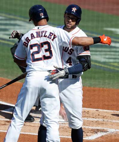 Houston Astros George Springer embraces Michael Brantley (23) after hitting a solo home off Tampa Bay Rays starter John Curtiss during the first inning of Game 5 of the American League Championship Series at Petco Park Thursday, Oct. 15, 2020, in San Diego. Photo: Karen Warren, Staff Photographer / © 2020 Houston Chronicle