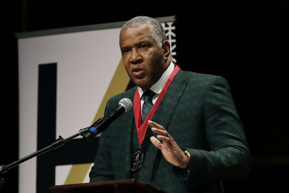 FILE - In this Oct. 22, 2019, file photo, billionaire businessman Robert F. Smith speaks after receiving the W.E.B. Dubois Medal for contributions to black history and culture, during ceremonies at Harvard University in Cambridge, Mass. Federal prosecutors announced Thursday, Oct. 15, 2020, that Smith, founder and chairman of investment firm Vista Equity Partners, will cooperate in the investigation and pay $139 million to settle a tax probe.