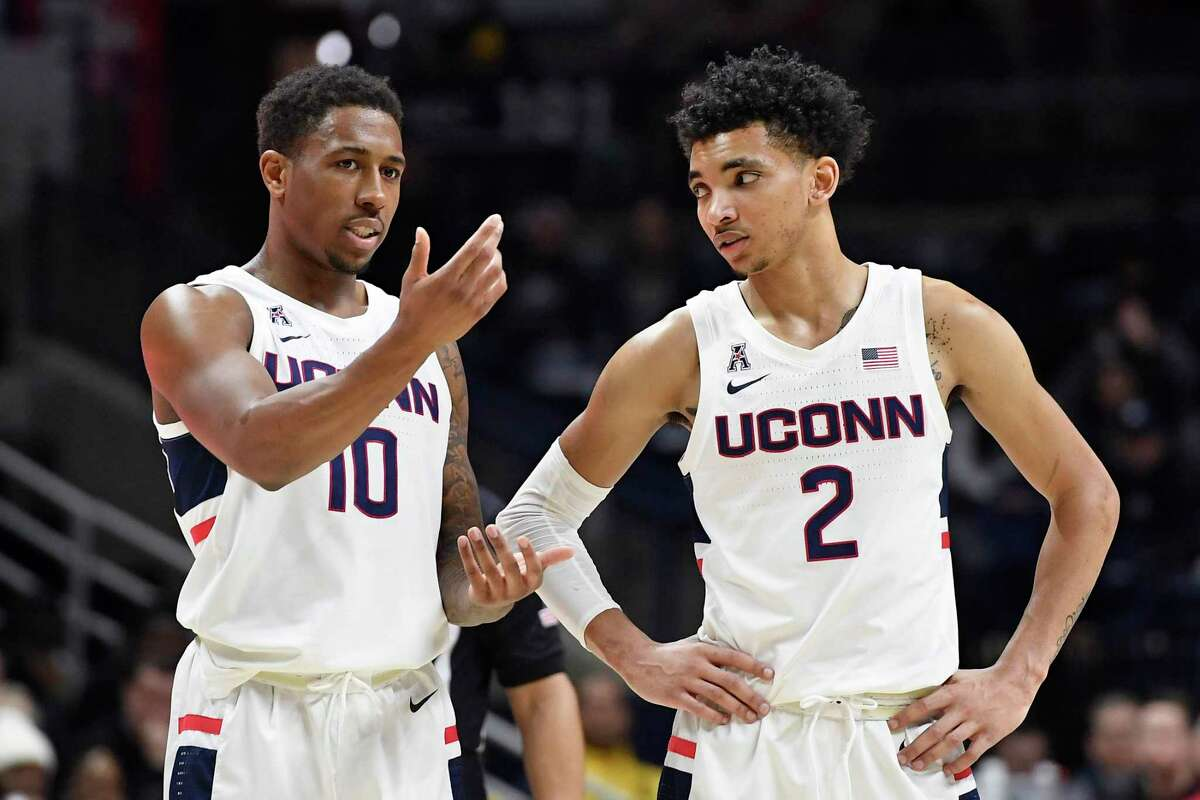 Connecticut's Brendan Adams (10) and Connecticut's James Bouknight (2) in the first half of an NCAA college basketball game, Sunday, Feb. 9, 2020, in Storrs, Conn. (AP Photo/Jessica Hill)