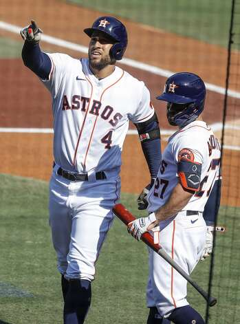 Houston Astros George Springer, with Jose Altuve, points to third base coach Gary Pettis, who is watching from the owner's box, after hitting a solo home off Tampa Bay Rays starter John Curtiss during the first inning of Game 5 of the American League Championship Series at Petco Park Thursday, Oct. 15, 2020, in San Diego. Pettis is undergoing treatment for cancer. Photo: Karen Warren/Staff Photographer / © 2020 Houston Chronicle
