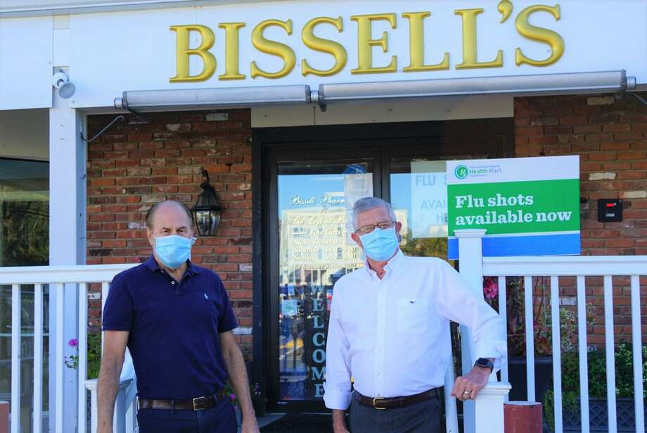 Bissell Pharmacy owner Ed Karvosky and Bob Hebert. Photo: Contributed Photo