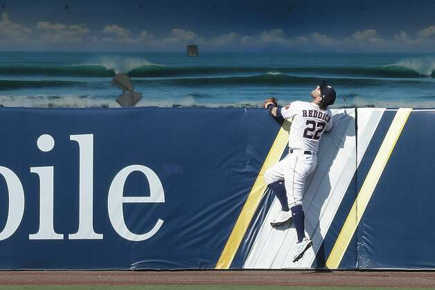 Houston Astros Josh Reddick looks up at a home run ball hit by Tampa Bay Rays Brandon Lowe during the third inning of Game 5 of the American League Championship Series at Petco Park Thursday, Oct. 15, 2020, in San Diego. Photo: Karen Warren/Staff Photographer / © 2020 Houston Chronicle