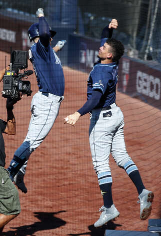 Tampa Bay Rays Brandon Lowe and Willy Adames celebrate Lowe's solo home run off Houston Astros reliever Blake Taylor during the third inning of Game 5 of the American League Championship Series at Petco Park Thursday, Oct. 15, 2020, in San Diego. Photo: Karen Warren/Staff Photographer / © 2020 Houston Chronicle