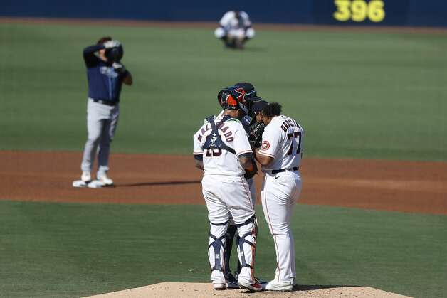 Houston Astros catcher Martin Maldonado and starting pitcher Luis Garcia meet on the mound during the second inning of Game 5 of the American League Championship Series against the Tampa Bay Rays at Petco Park Thursday, Oct. 15, 2020, in San Diego. Photo: Karen Warren/Staff Photographer / © 2020 Houston Chronicle