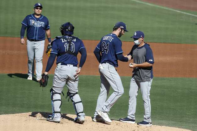 Tampa Bay Rays manager Kevin Cash pulls starter John Curtiss (84) during the second inning of Game 5 of the American League Championship Series against the Houston Astros at Petco Park Thursday, Oct. 15, 2020, in San Diego. Photo: Karen Warren/Staff Photographer / © 2020 Houston Chronicle