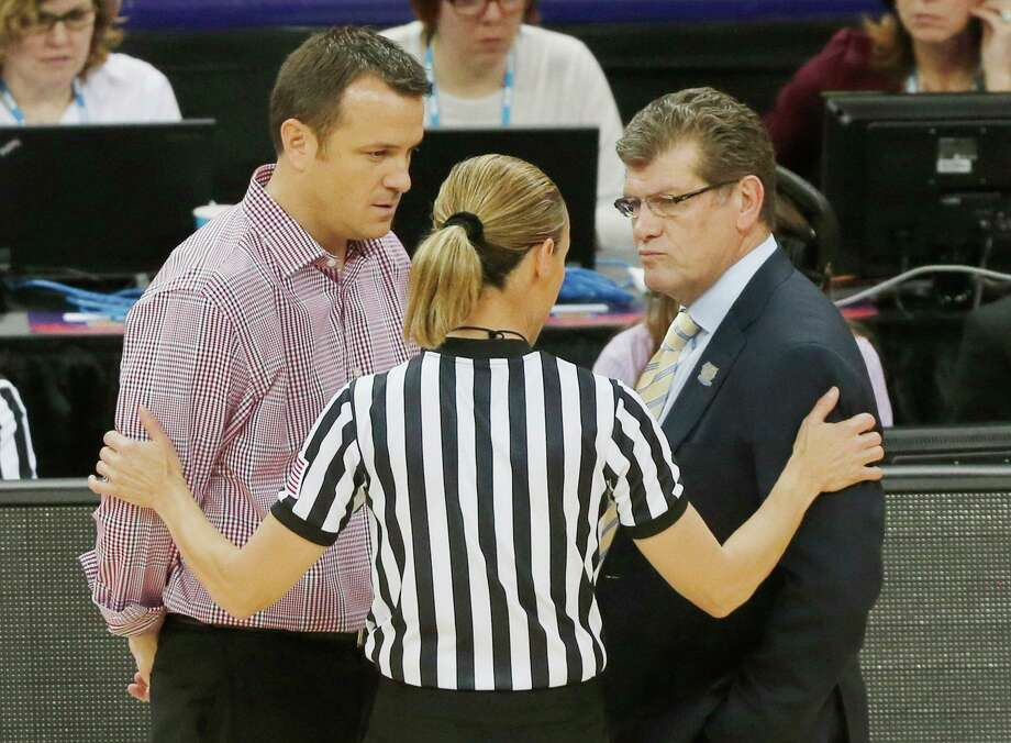 Louisville coach Jeff Walz, left, and UConn coach Geno Auriemma talk to an official during the national championship game at the 2103 Final Four. Photo: Bill Haber / Associated Press / FR170136 AP